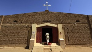 A South Sudanese worshipper arrives to attend Sunday prayers in Baraka Parish church at Hajj Yusuf, on the outskirts of Khartoum, February 10, 2013. Sudan